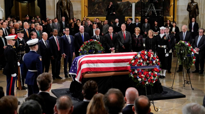 Members of President Donald Trump's cabinet stop to pay their respect in front of the flag-draped casket of former President George H.W. Bush at the Capitol in Washington, Monday, Dec. 3, 2018. Pablo Martinez Monsivais/Pool via REUTERS